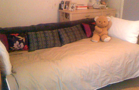 Jamie on the bed/sofa