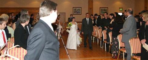 Ladan walking up the aisle